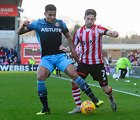 Stevenage's Luther Wildin under pressure from Lincoln City's Tom Pett<br /> <br /> Photographer Chris Vaughan/CameraSport<br /> <br /> The EFL Sky Bet League Two - Lincoln City v Stevenage - Saturday 16th February 2019 - Sincil Bank - Lincoln<br /> <br /> World Copyright © 2019 CameraSport. All rights reserved. 43 Linden Ave. Countesthorpe. Leicester. England. LE8 5PG - Tel: +44 (0) 116 277 4147 - admin@camerasport.com - www.camerasport.com