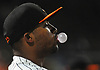 Robert Garcia #14 of the Long Island Ducks blows a bubble with his gum in the top of the ninth inning of the team's season home opener against the Southern Maryland Blue Crabs at Bethpage Ballpark in Central Islip, NY on Friday, May 4, 2018.
