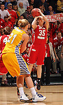 SIOUX FALLS, SD - MARCH 12:  Nicole Seekamp #35 from the University of South Dakota spots up for a jumper against South Dakota State University in the second half of the 2013 Women's Summit League Championship Game on Tuesday afternoon at the Sioux Falls Arena. (Photo by Dave Eggen/Inertia)