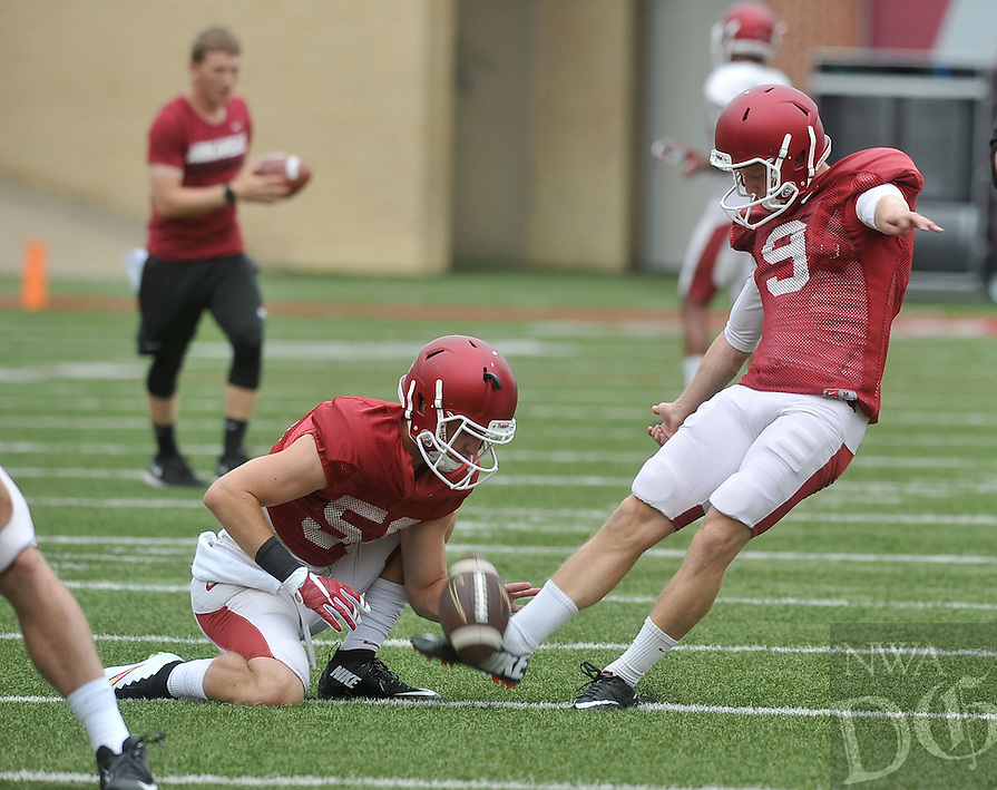 NWA Democrat-Gazette/MICHAEL WOODS &bull; @NWAMICHAELW<br /> University of Arkansas kicker Cole Hedlund (9) kicks a field goal during practice Saturday August 22, 2015 at Razorback Stadium in Fayetteville.