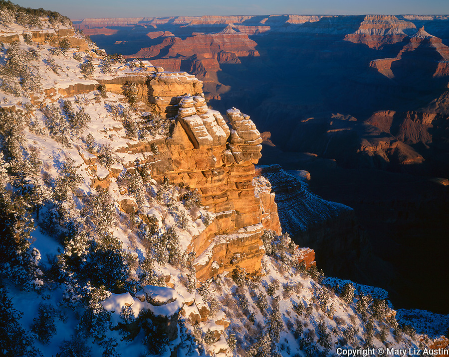 Grand Canyon National Park, AZ   <br /> First light on canyon walls with fresh snow at Mather Point, South Rim