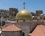 A rooftop view of the Christian Quarter in the Old City of Jerusalem.  In the foreground is the golden dome of the Greek Orthodox Church of Saint John the Baptist, with the Tower of Phasael in the Citadel or Tower of David behind at right. The Old City of Jerusalem and its Walls - UNESCO World Heritage Site