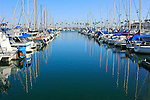A view of sailboats docked in Long Beach harbor California.