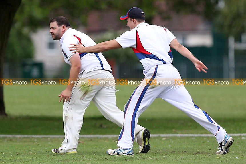 Hornchurch Athletic claim the 5th Brookweald wicket - Hornchurch Athletic CC vs Brookweald CC - Mid-Essex Cricket League at Hylands Park - 30/08/14 - MANDATORY CREDIT: Gavin Ellis/TGSPHOTO - Self billing applies where appropriate - contact@tgsphoto.co.uk - NO UNPAID USE