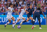 PARIS,  - JUNE 28: Alex Morgan #13 dribbles upfield during a game between France and USWNT at Parc des Princes on June 28, 2019 in Paris, France.