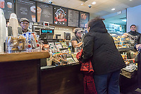 Customers in a busy Starbucks in Queens in New York on Saturday, February 13, 2016.  (© Richard B. Levine)