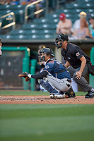 John Ryan Murphy (9) of the Reno Aces in front of home plate umpire Alex Ziegler during the game against the Salt Lake Bees at Smith's Ballpark on June 26, 2019 in Salt Lake City, Utah. The Aces defeated the Bees 6-4. (Stephen Smith/Four Seam Images)