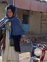 A foot soldier of teenage years from the Wardak Mobile Patrol Unit with an AK47 machine gun before going out on patrol