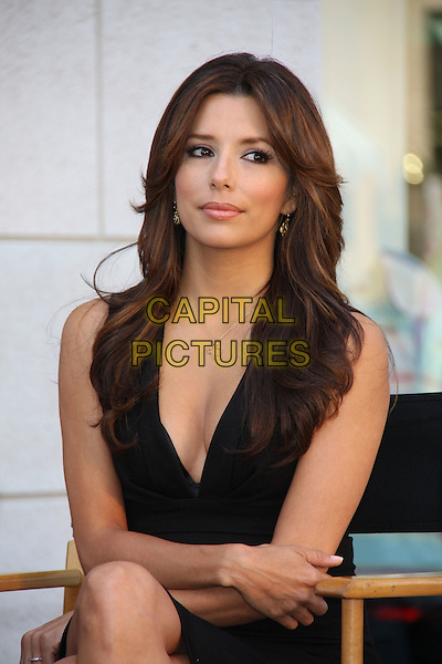 EVA LONGORIA PARKER.Kids with Cancer Press Conference held at the Glendale Galleria, Glendale, California, USA,.31st March 2009..half length black dress cleavage sitting in chair gold necklace .CAP/ADM/KB.©Kevan Brooks/Admedia/Capital PIctures
