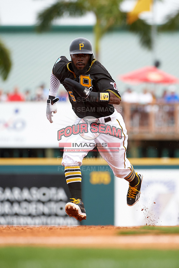 Pittsburgh Pirates second baseman Josh Harrison (5) running the bases during a Spring Training game against the Toronto Blue Jays  on March 3, 2016 at McKechnie Field in Bradenton, Florida.  Toronto defeated Pittsburgh 10-8.  (Mike Janes/Four Seam Images)