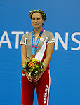 Kirby Cot? won the gold again in 200 m ind.race.<br />