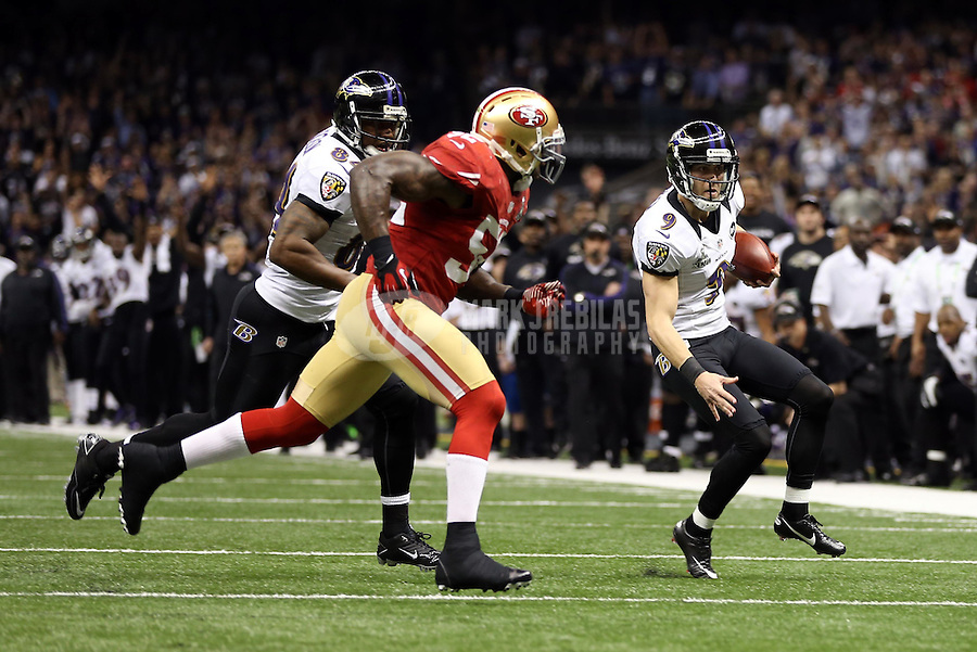 Feb 3, 2013; New Orleans, LA, USA; Baltimore Ravens kicker Justin Tucker (9) runs the ball on a fake field goal against the San Francisco 49ers in the second quarter in Super Bowl XLVII at the Mercedes-Benz Superdome. Mandatory Credit: Mark J. Rebilas-