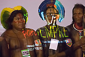 Altamira, Brazil. Encontro Xingu protest meeting about the proposed Belo Monte hydroeletric dam and other dams on the Xingu river and its tributaries. kayapo chiefs with the emblem of the Encontro projected onto them.