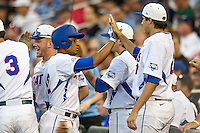 Florida Gators shortstop Richie Martin (12) celebrates with the dugout after scoring against the Miami Hurricanes in the NCAA College World Series on June 13, 2015 at TD Ameritrade Park in Omaha, Nebraska. Florida defeated Miami 15-3. (Andrew Woolley/Four Seam Images)