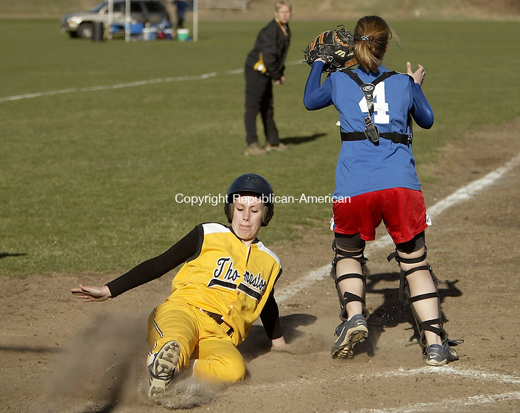 WOODBURY, CT- 11 APRIL 2005-041105J01--Thomaston's Drew Gomes slides safely into home as Nonnewaug's catcher Catlin South waits for the throw during their Berkshire League game Monday at Nonnewaug High School in Woodbury. --- Jim Shannon Photo--Nonnewaug; Thomaston; Drew Gomes, Catlin South are CQ