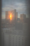 Encore high rise resort hotel through the curtain of a Circus Circus Hotel room, Las Vegas Strip, sunrise.