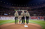 First Lady Michelle Obama and Dr. Jill Biden, with veteran James Sperry and his daughter, Hannah, pause for the national anthem prior to Game 1 of the World Series at Busch Stadium in St. Louis, Missouri, October 19, 2011. The First Lady and Dr. Biden attended the game as part of their Joining Forces initiative..Mandatory Credit: Lawrence Jackson - White House via CNP