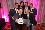 The Scotland team of Max Evans, Thom Evans, Alan Hansen, Kenny Dalglish, Rory Lawson and Gordon Strachan pose for a selfie at the gala dinner.<br /> The Celebrity Cup 2015<br /> Celtic Manor Resort<br /> <br /> 04.07.15<br /> &copy;Steve Pope - SPORTINGWALES