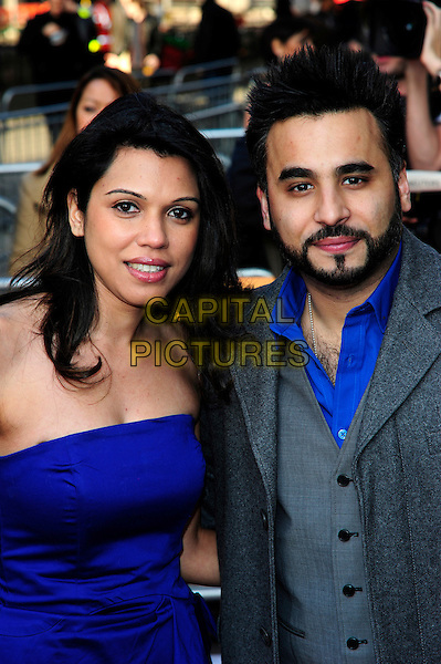 AMEET CHANA & GUEST.Attending the World premiere gala screening of 'The Infidel' held at the Hammersmith Apollo, London, England, UK, April 8th, 2010..arrivals half length strapless blue grey gray beard facial hair goatee shirt suit jacket waistcoat .CAP/CJ.©Chris Joseph/Capital Pictures.