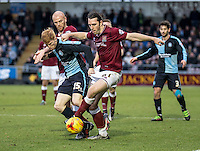 Ryan Sellers of Wycombe Wanderers grabs on tight to John-Joe's O'Toole of Northampton Town during the Sky Bet League 2 match between Northampton Town and Wycombe Wanderers at Sixfields Stadium, Northampton, England on the 20th February 2016. Photo by Liam McAvoy.