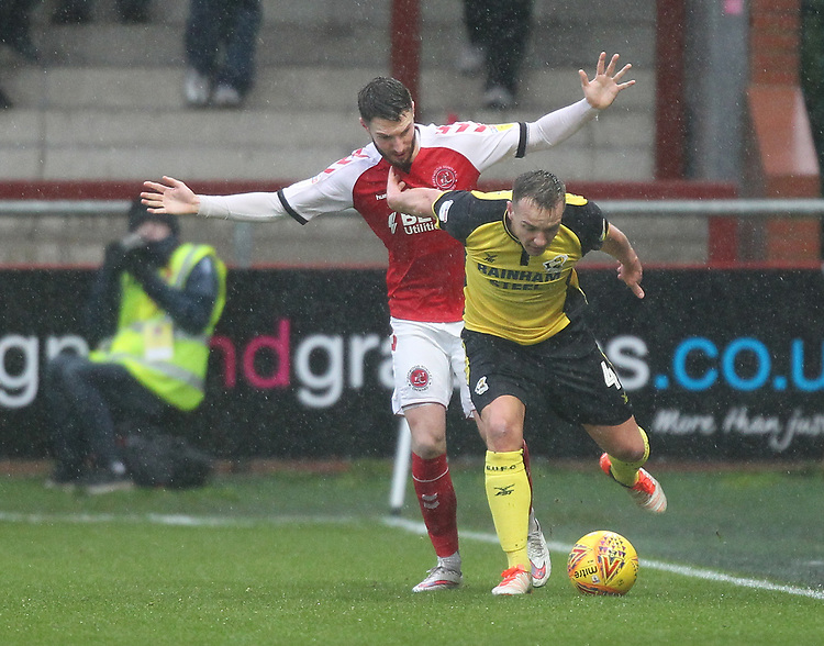 Fleetwood Town's James Husband battles with Scunthorpe Utd's Anthony McMahon<br /> <br /> Photographer Mick Walker/CameraSport<br /> <br /> The EFL Sky Bet League One - Fleetwood Town v Scunthorpe United - Saturday 26th January 2019 - Highbury Stadium - Fleetwood<br /> <br /> World Copyright © 2019 CameraSport. All rights reserved. 43 Linden Ave. Countesthorpe. Leicester. England. LE8 5PG - Tel: +44 (0) 116 277 4147 - admin@camerasport.com - www.camerasport.com