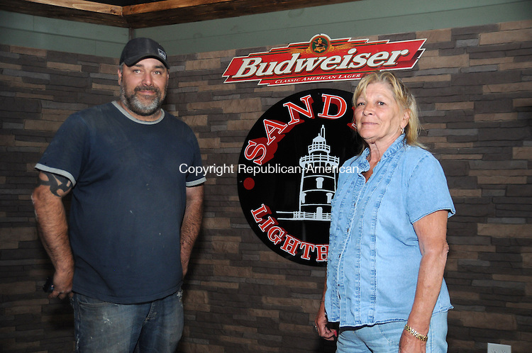 WESTERLY, RI, 17 MAY 13- 051713AJ16- Sandy Daggett and her son Steve Daggett stand on a stage in her rebuilt bar and grille, Sandy's Light House, on Atlantic Avenue in Westerly, R.I.   Alec Johnson/ Republican-American
