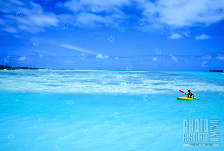 Kayaking in a blue lagoon off Aitutaki, Cook Islands
