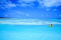 Kayaking in a blue lagoon off Aitutaki, Cook Islands