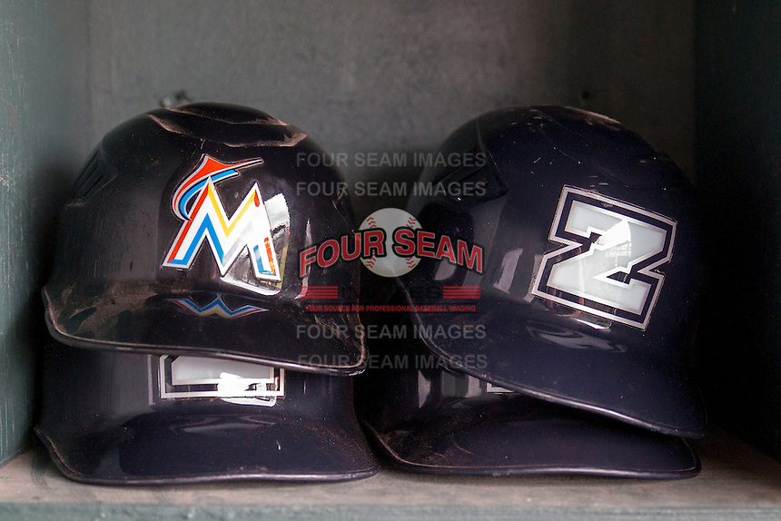Miami Marlins and New Orleans Zephyrs helmets in the dugout on May 27, 2014 at the Dell Diamond in Round Rock, Texas. (Andrew Woolley/Four Seam Images)