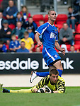 St Johnstone v Man Utd XI....31.07.10  Alan Main Testimonial.Marcus haber cooly slots the ball past keeper Sam Johnstone.Picture by Graeme Hart..Copyright Perthshire Picture Agency.Tel: 01738 623350  Mobile: 07990 594431