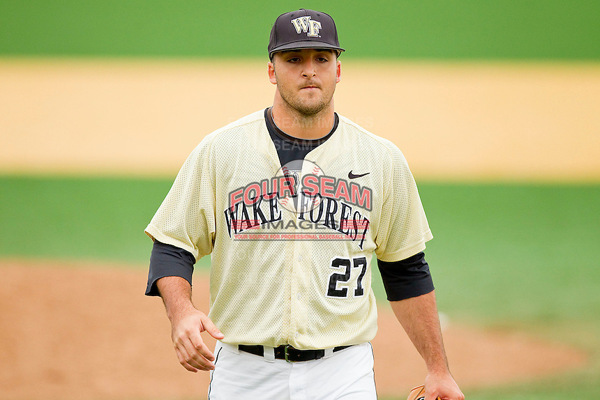 Wake Forest Demon Deacons relief pitcher Niko Spezial #27 walks off the field after getting the third out of the 7th inning against the Florida State Seminoles at Wake Forest Baseball Park on March 25, 2012 in Winston-Salem, North Carolina.  The Demon Deacons defeated the Seminoles 7-5.  (Brian Westerholt/Four Seam Images)