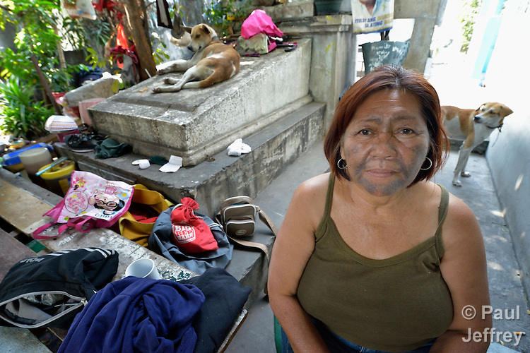 "A woman in the Manila North Cemetery. Hundreds of poor families live here, dwelling in and between the tombs and mausoleums of the city's wealthy. They are often discriminated against, and many of their children don't go to school because they're too hungry to study and they're often called ""vampires"" by their classmates. With support from United Methodist Women, KKFI provides classroom education and meals to kids from the cemetery at a nearby United Methodist Church."