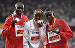 (l to r) Joshua Kiprui Cheptegei (UGA), Mo Farah (GBR) with his gold medal and Paul Kipngetich Tanui on the podium following the mens 10,000m. IAAF World athletics championships. London Olympic stadium. Queen Elizabeth Olympic park. Stratford. London. UK. 04/08/2017. ~ MANDATORY CREDIT Garry Bowden/SIPPA - NO UNAUTHORISED USE - +44 7837 394578