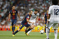 29.08.2012 Spain Supercopa, Real Madrid won (2-1) at Barcelona and was presented on goalaverage to win its ninth Supercopa of Spain) at Santiago Bernabeu stadium. The picture show Andres Iniesta Lujan (Spanish midfielder of Barcelona) and  Xabier Alonso (Spanish midfielder of Real Madrid)