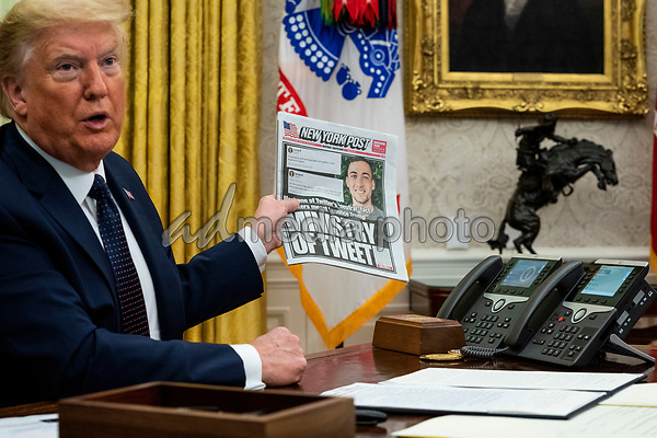 United States President Donald J. Trump, accompanied by US Attorney General William P. Barr, holds a copy of today's New York Post as he makes remarks before signing an executive order in the Oval Office of the White House in Washington, DC that will punish Facebook, Google and Twitter for the way they police content online, Thursday, May 28, 2020. <br /> Credit: Doug Mills / Pool via CNP/AdMedia