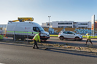 Pictured: Council employees clear debris from the central reservation the articulated M&S lorry crashed through on Fabian Way, Swansea, Wales, UK. Friday 20 September 2019<br /> Re: A Marks and Spencer articulated lorry has crashed through the central reservation of a dual carriageway and into a wall on the opposite side of the road on the A483 Fabian Road in the St Thomas area of Swansea, south Wales, UK.