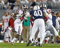 Ohio State Buckeyes running back Curtis Samuel (4) handles the ball during the 1st quarter of the NCAA Division I football game at Beaver Stadium in University Park, PA on October 25, 2014. (Columbus Dispatch photo by Jonathan Quilter)