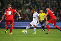 Pictured: Wayne Routledge of Swansea (C) marked by Russell Penn (L) and Eddie Nolan (R) of York Tuesday 25 August 2015<br /> Re: Capital One Cup, Round Two, Swansea City v York City at the Liberty Stadium, Swansea, UK.