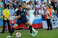 Cauley Woodrow of England and Milan Skriniar of Slovakia during Slovakia Under-21 vs England Under-21, UEFA European Under-21 Championship Football at The Kolporter Arena on 19th June 2017