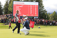 Matthew Fitzpatrick (ENG) and caddy Jamie on the 18th green during Sunday's Final Round of the 2017 Omega European Masters held at Golf Club Crans-Sur-Sierre, Crans Montana, Switzerland. 10th September 2017.<br /> Picture: Eoin Clarke | Golffile<br /> <br /> <br /> All photos usage must carry mandatory copyright credit (&copy; Golffile | Eoin Clarke)