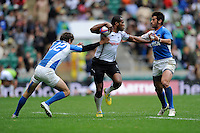 Watisoni Votu of Fiji is tackled by Franco Sabato (left) and Valentin Cruz of Argentina during the iRB Marriott London Sevens at Twickenham on Saturday 11th May 2013 (Photo by Rob Munro)