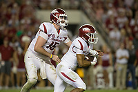 Hawgs Illustrated/BEN GOFF <br /> Cole Kelley, Arkansas quarterback, hands off to running back Chase Hayden in the second half against Alabama Saturday, Oct. 14, 2017, at Bryant-Denny Stadium in Tuscaloosa, Ala.