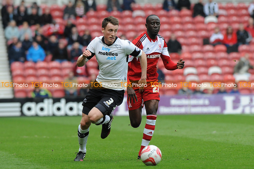 Craig Forsyth of Derby County battles with Albert Adomah of Middlesbrough - Middlesbrough vs Derby County - Sky Bet Championship Football at the Riverside Stadium, Middlesbrough - 05/04/14 - MANDATORY CREDIT: Steven White/TGSPHOTO - Self billing applies where appropriate - 0845 094 6026 - contact@tgsphoto.co.uk - NO UNPAID USE