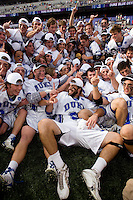 Duke poses with the trophy after the NCAA Men's Lacrosse Championship held at M&T Stadium in Baltimore, MD.  Duke defeated Notre Dame, 6-5, to win the title in overtime.