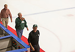 Jerry Nuerge, Elmer Gates, and Jake Peterson walk down the ice with other 1960s hockey alumni after the first period of the OU hockey game on September 30, 2016.