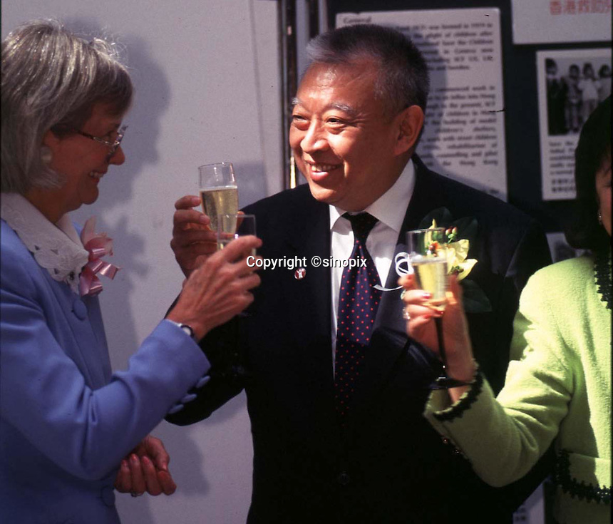 290897: HONG KONG: TUNG CHEE HWA<br /> <br /> TUNG CHEE HWA TOASTS DURING A MEETING WITH PEOPLE FROM HK SAVE THE CHILDREN FUND.<br /> <br /> PHTO BY RICHARD JONES / SINOPIX