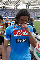 Napoli's Uruguayan   Edinson Cavani cries as he celebrates victory and the qualification of the SSC Napoli team in the UEFA Champions League during the Italian Serie A football match between SSC Napoli and Siena at the San Paolo stadium in NaplesNAPOLI CACIO FESTA QUALIFICAZIONE  CHAMPIONS