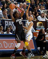 Layshia Clarendon of California in action against Chiney Ogwumike of Stanford during the game at Haas Pavilion in Berkeley, California on January 8th, 2013.  Stanford defeated California, 62-53.