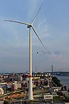 GERMANY Hamburg, new Nordex wind turbine at water treatment plant of Hamburg Wasser  in harbour / DEUTSCHLAND Hamburg, neue Nordex Windkraftanlage auf dem Gelaende Klaerwerk Koehlbrandhoeft von Hamburg Wasser im Hamburger Hafen, links HHLA Containerterminal Tollerort