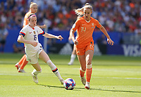 DECINES-CHARPIEU, FRANCE - JULY 07: Rose Lavelle #16, Jackie Groenen #14 during the 2019 FIFA Women's World Cup France Final match between Netherlands and the United States at Groupama Stadium on July 07, 2019 in Decines-Charpieu, France.